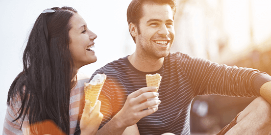 Happy couple eating ice cream