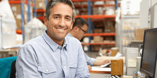 Male business owner smiling