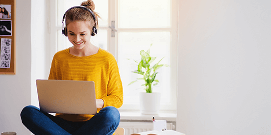 Girl on laptop with headphones